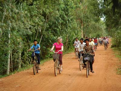 Cambodia---Volunteer-Leading-Bike-Caravan-to-Program-Site