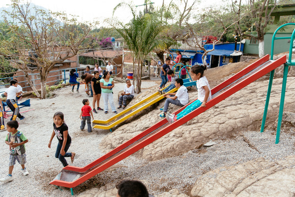 Children enjoy their refurbished playground