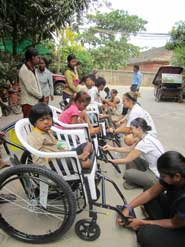 tall-Brandy-and-Emilee-with-Cambodians-fixing-wheelchairs