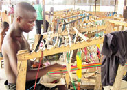 making-kente-clothging